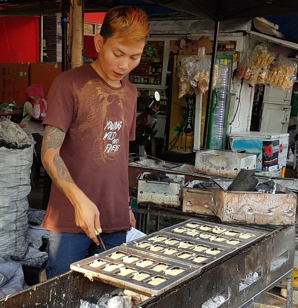 A Staff Is Baking Kue Balok